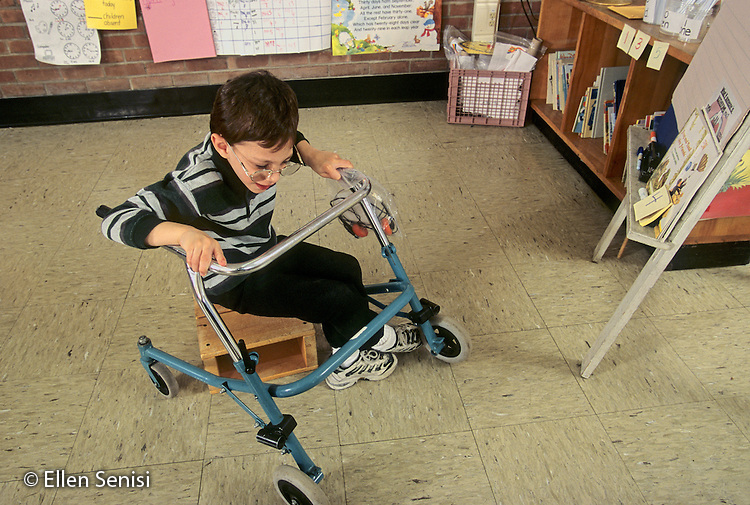 MR / Schenectady, New York. Zoller Public School / Inclusion Class Grade 1. Boy (7, cerebral palsy) transfers from block he uses as a stool. scan from slide MR: Aba1 ©Ellen B. Senisi