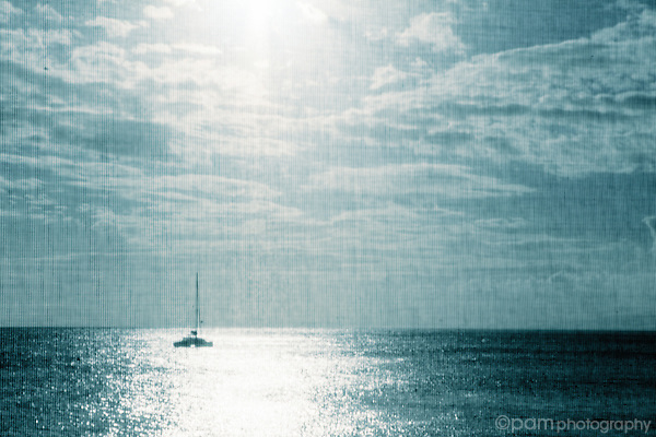 Textured image of sailboat on ocean with sun and cloads