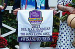 """DEL MAR, CA  AUGUST 21: The connections with their """"Win and You're In"""" saddle towel after  Astronaut, ridden by Victor Espinoza, wins the Del Mar Handicap (Grade ll) Breeders Cup """"Win and You're In"""" Turf Division on August 21, 2021 at Del Mar Thoroughbred Club in Del Mar, CA  (Photo by Casey Phillips/Eclipse Sportswire/CSM)"""