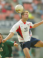 Brian McBride takes a header in air. The USA defeated Mexico 2-0 in the Round of 16 of the FIFA World Cup 2002 in South Korea on June 17, 2002.