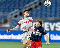 FOXBOROUGH, MA - OCTOBER 7: Marco Delgado #8 of Toronto FC and Tommy McNamara #26 of New England Revolution battle for head ball during a game between Toronto FC and New England Revolution at Gillette Stadium on October 7, 2020 in Foxborough, Massachusetts.
