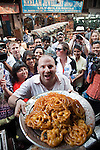 26 OCTOBER 2012:   MasterChef's George Calombaris on a food tour by rickshaw of Old Delhi. During the tour he tasted such local delights as as rice pudding and sweets like Jalebi (pictured)while enjoying the sights  during his visit to India as ambassadors for Oz Fest. Picture by Graham Crouch