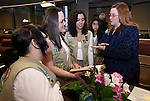 Nevada Assemblywoman Maggie Carlton, D-Las Vegas, talks with state Girl Scouts before the opening day of the 77th Legislative Session in Carson City, Nev. on Monday, Feb. 4, 2013. <br />