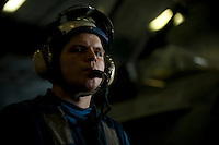 120315-N-DR144-639 ARABIAN SEA (March 15, 2012) Aviation Boatswain's Mate (Handling) Airman William Arms, assigned to the Air Department's V-3 Division, assists in the movement of aircraft in the hangar bay aboard the Nimitz-class aircraft carrier USS Carl Vinson (CVN 70). Carl Vinson and Carrier Air Wing (CVW) 17 are deployed to the U.S. 5th Fleet area of responsibility.  (U.S. Navy photo by Mass Communication Specialist 2nd Class James R. Evans/Released)
