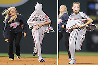 PHOTO ILLUSTRATION:  Eleven-year-old Tyler Scholl of Powdersville, S.C., plays a game requiring him to put on a drive uniform and run the bases in-between innings of the Opening Day game between the Greenville Drive and Lakewood BlueClaws on April 5, 2012, at Fluor Field at the West End in Greenville, South Carolina. (Tom Priddy/Four Seam Images)