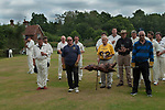 Ebernoe Horn Fair, Sussex 2017. Traditional St James Day (July 25th)  Lamb Roast procession. The cricket teams lamb is donated The Leconfield Estates which is a private traditional landed agricultural estate in West Sussex. The Estates are in the ownership of Lord Egremont. Players walk to the cricket pavilion while the hymn Jerusalem is  played over loud speakers. Prayers are read remembering those no longer with us.