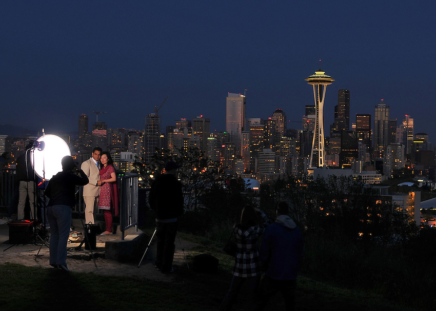 Newlyweds have their photo taken at Queen Anne Hill in Seattle.