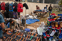Sellers display belts and shoes for sale in the street market on Meena Bazar in the Chadni Chowk area of Delhi, India, on Tue., Dec. 11, 2018.