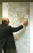 Roger Thomson, a sergeant in the Homicide and Sex Section of the Montgomery County, Maryland Police Department, points to a map of the Washington DC area, marked with the sniper shooting sites during his testimony in the trial of sniper suspect John Allen Muhammad in Virginia Beach Circuit Court in Virginia Beach, Virginia on November 9, 2003. <br /> Credit: Tracy Woodward - Pool via CNP
