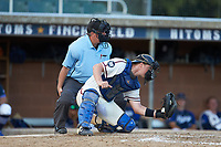 High Point-Thomasville HiToms catcher Jonathan Barham (35) (College of Charleston) frames a pitch as home plate umpire Brian Pitts looks on during the game against the Martinsville Mustangs at Finch Field on July 26, 2020 in Thomasville, NC.  The HiToms defeated the Mustangs 8-5. (Brian Westerholt/Four Seam Images)