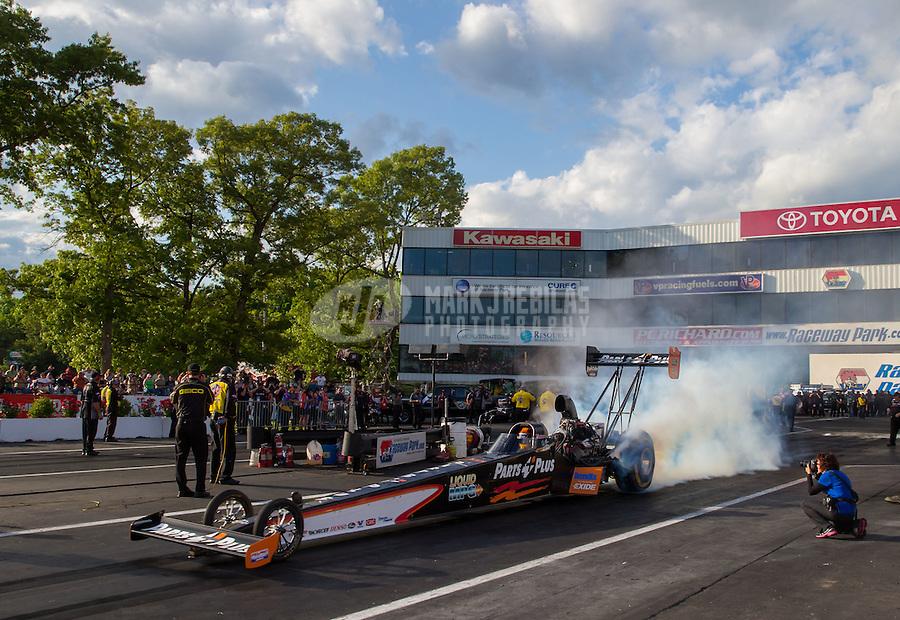May 30, 2014; Englishtown, NJ, USA; NHRA top fuel driver Clay Millican during qualifying for the Summernationals at Raceway Park. Mandatory Credit: Mark J. Rebilas-