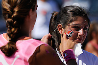 A fan gets a Sky Blue temporary tattoo while watching the finals of the 2011 FIFA Women's World Cup prior to a Women's Professional Soccer (WPS) match between Sky Blue FC and the Western New York Flash at Yurcak Field in Piscataway, NJ, on July 17, 2011.