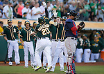 Josh Donaldson celebrates his home run with teammates.<br /> Boston Red Sox at Oakland A's at O.Co coliseum in Oakland, June 20, 2014