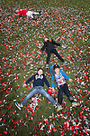© Joel Goodman - 07973 332324 . 25/04/2015 . Salford , UK . Children lie in black red and white confetti , spread over the pitch , after the match . Evostick League champions , Salford FC , play Osset Town , in Salford . Photo credit : Joel Goodman