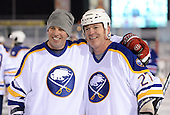 Matthew Barnaby (36) and Brad May (27) pose for photos after The Frozen Frontier Buffalo Sabres vs. Rochester Amerks Alumni Game at Frontier Field on December 15, 2013 in Rochester, New York.  (Copyright Mike Janes Photography)