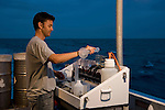Craig Humphrey of AIMS doing a water quality test aboard the research vessel Cape Ferguson
