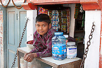 Kathmandu, Nepal.  Nepalese Boy at Sidewalk Cafe Refreshment Stand.