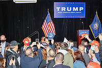 People crowd the stage area as Donald Trump, Jr., the son of US president Donald Trump, greets people after speaking at a 'Make America Great Again!' campaign rally at DoubleTree by Hilton MHT in Manchester, New Hampshire, on Thu., Oct. 29, 2020. The event took place five days before the Nov. 3 presidential election.