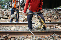 Workers conduct maintenance on a rail track that was damaged during the floods of January 2013. The floods damaged infrastructure throughout the city, causing the evacuation of <br /> approximately 20,000 people and the death of over 40 people.