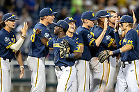 Michigan Wolverines second baseman Ako Thomas (4) celebrates with his teammates following Game 6 of the NCAA College World Series against the Florida State Seminoles on June 17, 2019 at TD Ameritrade Park in Omaha, Nebraska. Michigan defeated Florida State 2-0. (Andrew Woolley/Four Seam Images)