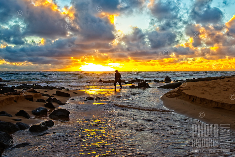 Sunrise walk on a beach near Kauai Beach Villas, Lihu'e, Kaua'i.