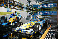 A model stands beside a Renault_F1 at The Beijing International Automobile Exhibition..19 Nov 2006