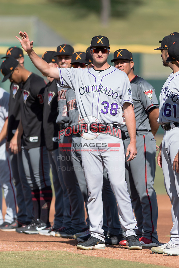 Salt River Rafters pitcher Ryan Castellani (38), of the Colorado Rockies organization, during player introductions before the Arizona Fall League Championship game against the Peoria Javelinas at Scottsdale Stadium on November 17, 2018 in Scottsdale, Arizona. Peoria defeated Salt River 3-2 in extra innings. (Zachary Lucy/Four Seam Images)