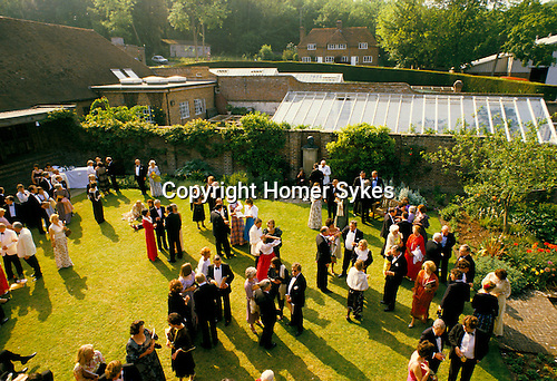 Glyndebourne Festival Opera East Sussex UK drinks on one of the lawns before the start of the evenings opera. 1985