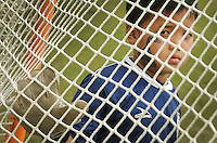 """Kelly.Jordan@jacksonville.com--111911--Thanaung Soe, 9, of Burma looks through the net of the goal he is defending for his soccer game during the """"Kickin' It For Refugees"""" Soccer Fun Day on the UNF campus Saturday November 19, 2011. The soccer fun day is an opportunity for the UNF community to welcome 80 refugee children and their families to campus in the spirit of celebrating the children's academic and personal achievements. UNF departments, student clubs and local businesses that participated in donating items to the refugee families will be recognized at the event. This event is a part of the UNF Reads! Program and is co-sponsored by the Honors Program.(The Florida Times-Union, Kelly Jordan)"""