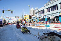 Mitch Seavey and team leave the ceremonial start line with an Iditarider and handler at 4th Avenue and D street in downtown Anchorage, Alaska on Saturday March 4th during the 2017 Iditarod race. Photo © 2017 by Brendan Smith/SchultzPhoto.com.