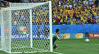 CUIABA - BRASIL -24-06-2014. Eiji Kawashima arquero de Japón (JPN) trata de atajar el gol de Juan Cuadrado (#11) de Colombia (COL) durante partido del Grupo C de la Copa Mundial de la FIFA Brasil 2014 jugado en el estadio Arena Pantanal de Cuiaba./ Eiji Kawashima goalkeeper of Japan (JPN)  tries to catch the ball in the goal of Juan Cuadrado (#11) player of Colombia (COL) during the macth of the Group C of the 2014 FIFA World Cup Brazil played at Arena Pantanal stadium in Cuiaba. Photo: VizzorImage / Alfredo Gutiérrez / Contribuidor
