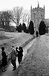 Upper Slaughter, Gloucestershire 1975. England. Church Sunday morning, St Peter's Church.<br /> <br /> Mr Robert Cookson and Mr Claud Forth.