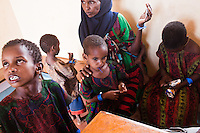 A Somali refugee family exhausted and dazed after arriving from Somalia to Ifo camp. They will be processed as new arrivals, given medical screeening, vaccinations and  food rations.