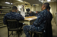 130425-N-DR144-115 Pacific Ocean (April 23, 2013)- Aviation Boatswain's Mate (Handling) 3rd Class Christopher Yakimowich salutes before beginning a Bluejacket of the Quarter board with representatives from the first class petty officer's mess in the ship's library aboard the amphibious transport dock ship USS Anchorage (LPD 23). Anchorage is currently en route to its namesake city of Anchorage, Alaska for its commissioning ceremony May 4. (U.S. Navy photo by Mass Communication Specialist 1st Class James R. Evans / RELEASED)