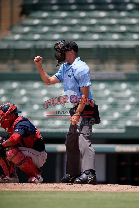Umpire Kaleb Martin calls a strike during a Gulf Coast League game between the GCL Red Sox and GCL Orioles on July 29, 2019 at Ed Smith Stadium in Sarasota, Florida.  GCL Red Sox defeated the GCL Pirates 9-1.  (Mike Janes/Four Seam Images)