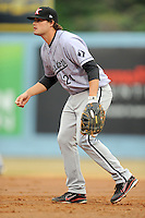 Kannapolis Intimidators first baseman Patrick Palmeiro #24 reacts to the ball during a game against the Asheville Tourists at McCormick Field on May 10, 2013 in Asheville, North Carolina. The Intimidators won the game 5-2. (Tony Farlow/Four Seam Images).