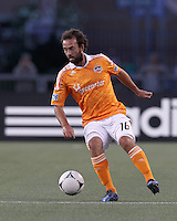 Houston Dynamo midfielder Adam Moffat (16) controls the ball. In a Major League Soccer (MLS) match, the New England Revolution tied Houston Dynamo, 2-2, at Gillette Stadium on May 19, 2012.
