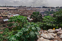 Nigeria. Enugu State. Enugu. View on Ogbete Main Market and on a wild garbage heap. The open air and uncontrolled rubbish dump shows the failure in the solid-waste management. Ogbete main market is the biggest commodity market. It is the choice market for wholesale buyers and sellers. Corrugated metal roofs. Enugu is the capital of Enugu State, located in southeastern Nigeria.  1.07.19 © 2019 Didier Ruef