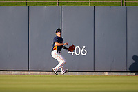 Houston Astros outfielder Myles Straw (3) attempts to catch a home run hit by Josh Bell (not shown) during a Major League Spring Training game against the Washington Nationals on March 19, 2021 at The Ballpark of the Palm Beaches in Palm Beach, Florida.  (Mike Janes/Four Seam Images)