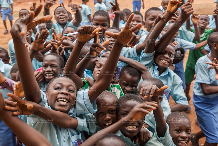 Nigeria. Enugu State. Enugu. Army Day Secondary School ( Awkunanaw in Igbo language). Igbo students laughing and pulling faces while standing in a yard outside their classroom, The pupils, all boys, wear blue uniforms and are 10-12 years old. They belong to the class JS1, Junior Secondary School. The Army Day Secondary School was inaugurated in October 1998. Enugu is the capital of Enugu State, located in southeastern Nigeria. 11.07.19 © 2019 Didier Ruef