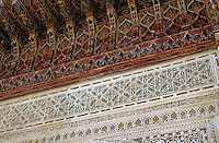 Brightly colored and intricately decorated wall and ceiling of Medersa Bou Inania.