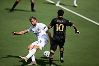 LOS ANGELES, CA - AUGUST 22: Carlos Vela #10 of the LAFC dribbles the ball past Emiliano Insua #3 of the Los Angeles Galaxy during a game between Los Angeles Galaxy and Los Angeles FC at Banc of California Stadium on August 22, 2020 in Los Angeles, California.
