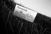 Douglas, Arizona.USA.October 20, 2006..A ranch owner living on the border with Mexico, where thousands of illegal immigrates cross, places a sign in his field against the possible crossing of terrorists at this border.