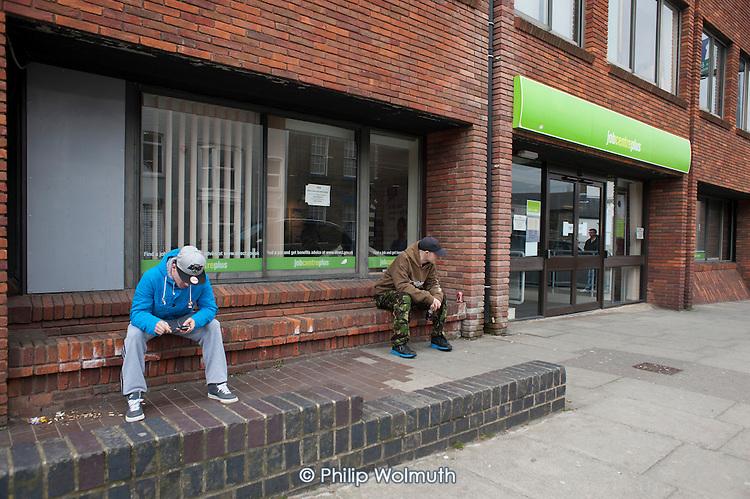 Unemployed young men outside Matgate Job Centre.
