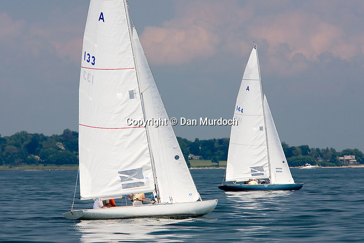 Racing sailboats on a calm day
