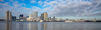 New Orleans, Louisiana.  City Skyline, Mississippi River.  World Trade Center on Left, St. Louis Basilica, French Quarter, Far Right.  New Orleans-Algiers Ferry in Center.