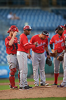 Louisville Bats manager Delino DeShields (90) makes a pitching change as Chris Berset (10) and Hernan Iribarren (2) look on during a game against the Syracuse Chiefs on June 6, 2016 at NBT Bank Stadium in Syracuse, New York.  Syracuse defeated Louisville 3-1.  (Mike Janes/Four Seam Images)
