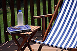 Reading Bill Bryson's travel book on the deck in summer
