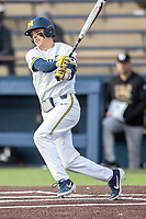 Michigan Wolverines second baseman Blake Nelson (10) follows through on his swing against the Western Michigan Broncos on March 18, 2019 in the NCAA baseball game at Ray Fisher Stadium in Ann Arbor, Michigan. Michigan defeated Western Michigan 12-5. (Andrew Woolley/Four Seam Images)