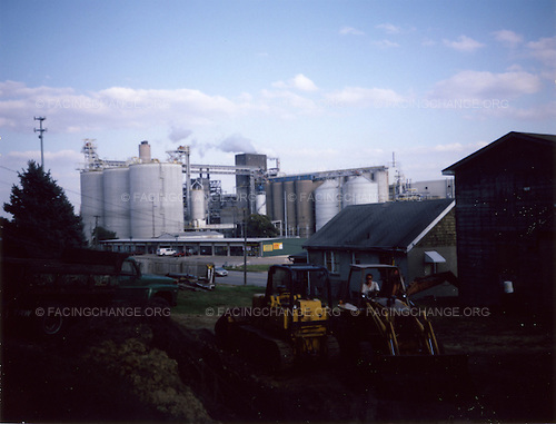 Iowa ,Davenport, <br /> USA.<br /> August 2008<br /> <br /> A view of homes next to a factory.